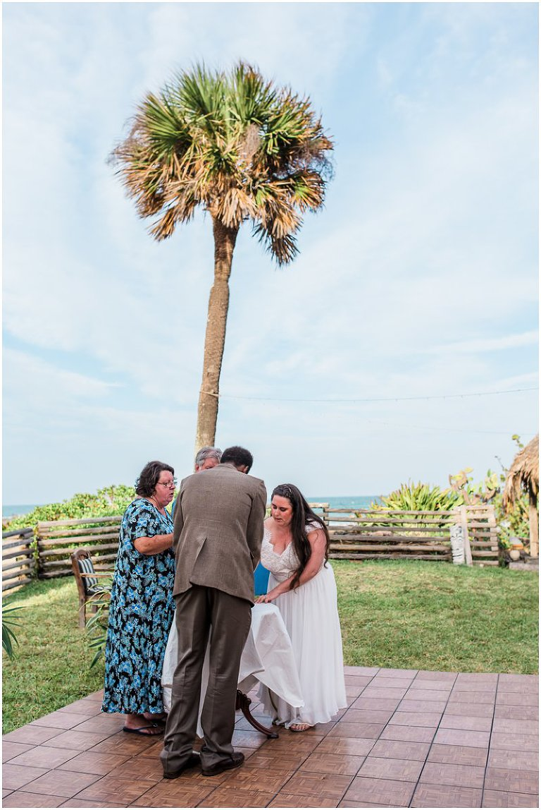Performing Knot Tying Ceremony During Cocoa Beach Wedding